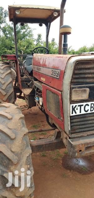Tractor And Plough/MF 399 4wd