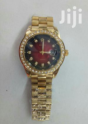 Gold and Red Rolex Watch