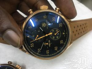 Orange and Gold Tagheure Quality Timepiece