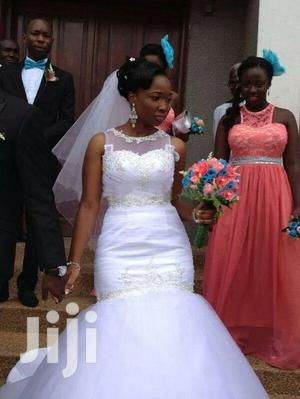 Tailor Made Wedding Gowns.