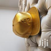 """Gold Leather Snapback With """"A""""   Clothing Accessories for sale in Mombasa, Mkomani"""