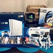 Sony Playstation 4 Pro 1TB Black Console Action Bundle + 4 Games | Video Game Consoles for sale in Mombasa, Bamburi