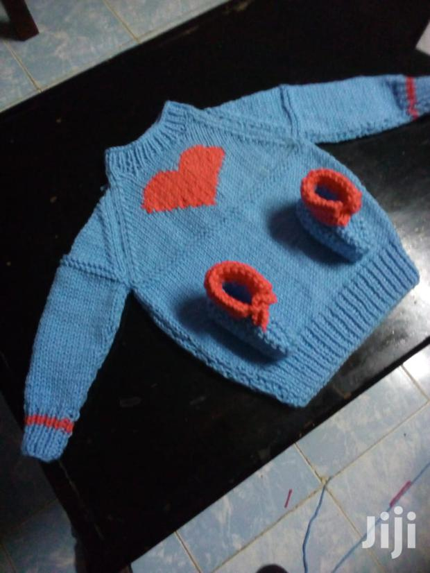 Knitted Baby Sweater Witn Socks